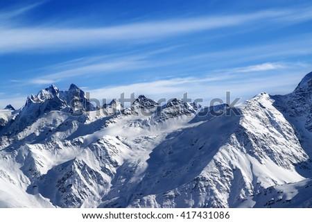 Snowy sunlight mountains, view from ski slope mt. Elbrus. Caucasus Mountains.  - stock photo