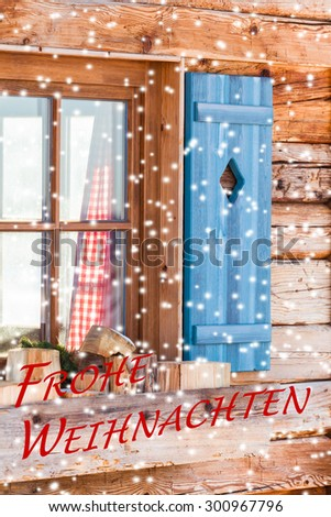 Snowy window detail of a bavarian alps wooden mountain hut with textual holiday message/Window of Bavarian Chalet in Winter - Merry Christmas (German) - stock photo