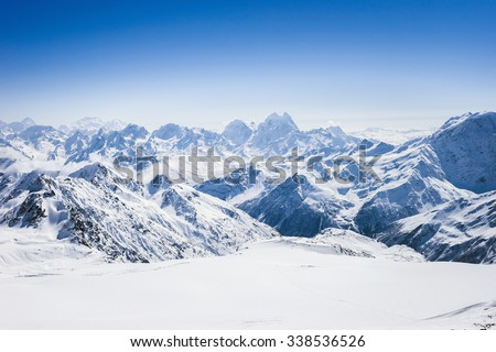 Snowy winter Greater Caucasus mountains at sunny day. View from ski slope Elbrus, Kabardino-Balkaria, Russia