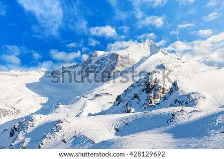 Snowy winter landscape of a ski resort in the Alps - stock photo
