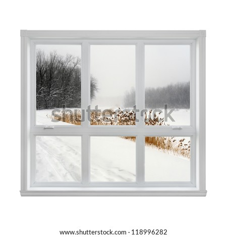 Snowy winter landscape seen through the window. - stock photo