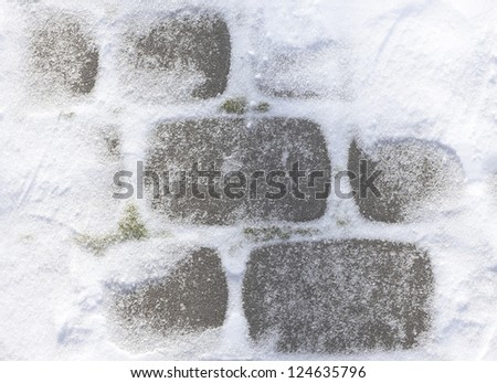 Snowy winter pavement close up - stock photo