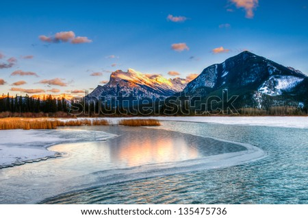Snowy winter scenery in the Canadian Rocky Mountains - Mount Rundle and Vermillion Lakes - Banff National Park, Alberta Canada - stock photo