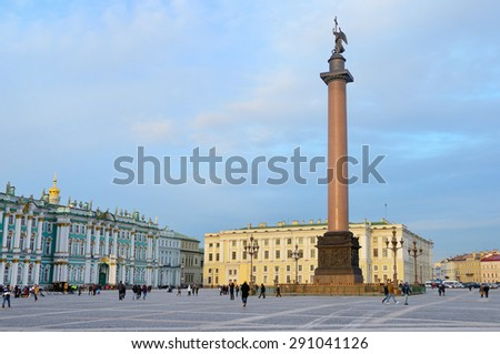 Snt. Peterburg, Russia, October, 25,2014. Russian scene: People walking  on Palace square ner the Alexander column and Zimny [Winter] Palace