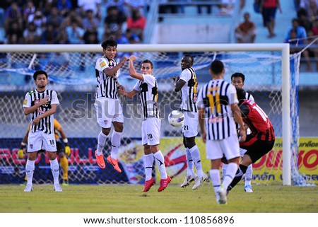 SOANGKHAL,THAILAND-5MAY:Mario Gjurovski (no.20)of SCG Muangthong Utd. for the ball duringThai Premier League between Wuachon Utd.and SCG Muangthong Utd.at Songkhla Stadium on May5,2012in Thailand - stock photo