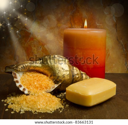 Soap and  flowers on wooden table - stock photo