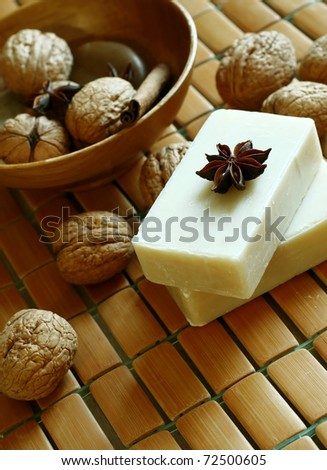 soap and walnuts on wooden - stock photo