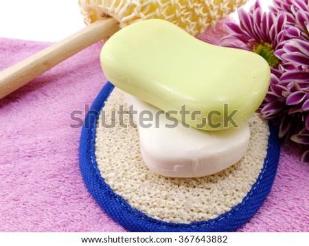 soap bar on white bath towel and scrub - stock photo