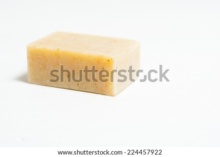 soap block on white wooden table, not isolated