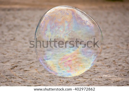 soap bubble flys over the street - stock photo