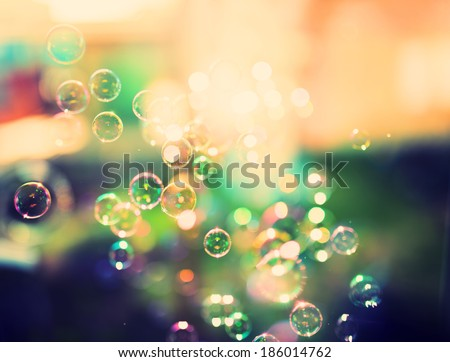 Soap bubbles, abstract background, retro tinted - stock photo