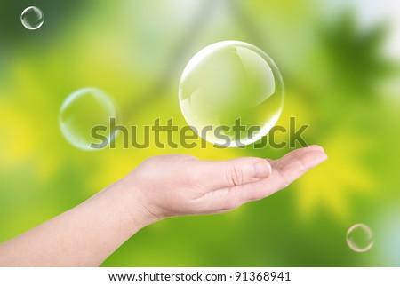 Soap bubbles on a palm. A children's entertainment - stock photo
