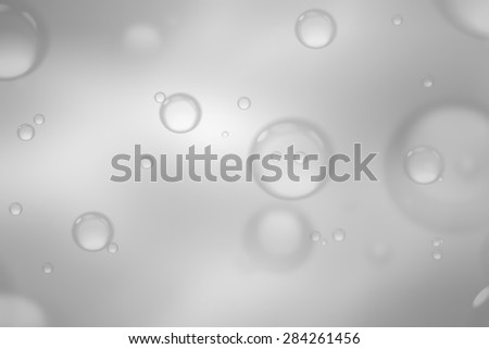 Soap bubbles on grey background, abstract background.