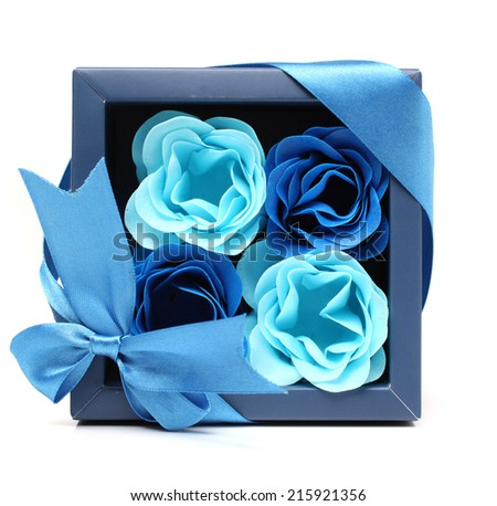 Soap in the shape of a flower in a blue gift box  - stock photo