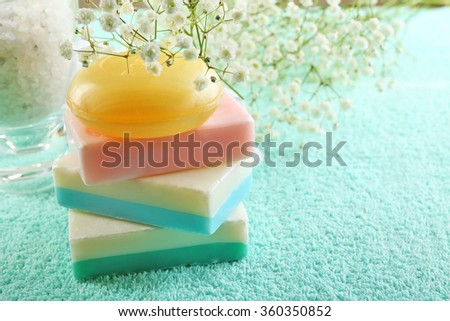 Soap set on a towel background, close up - stock photo