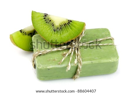 Soap with fresh kiwi on the white - stock photo