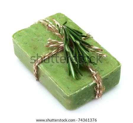 Soap with fresh rosemary closeup - stock photo