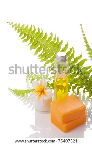 soaps decorated with leelawadee flower and fern leaf on white with clipping paths - stock photo