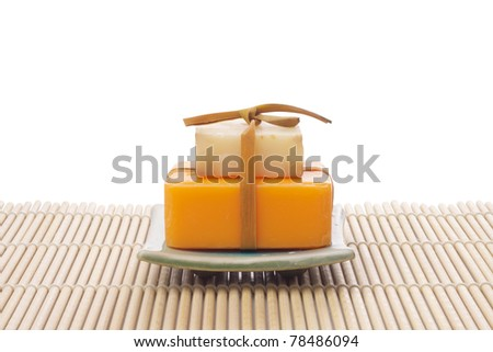 soaps on bamboo mat on white - stock photo