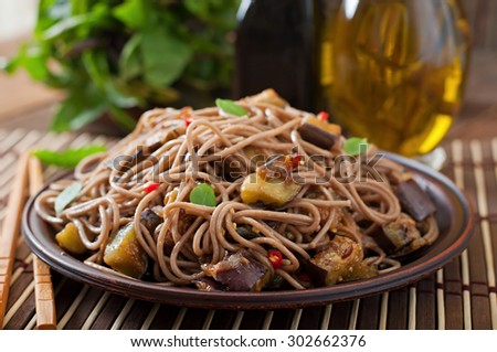 Soba noodles with eggplant in sweet and sour sauce - stock photo