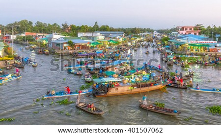 Soc Trang, Vietnam - February 3rd, 2016: Scenes dawn dusk floating market trading of farm produce on Tet crowded with boats out on confluence of the countryside is beautiful in Soc Trang, Vietnam