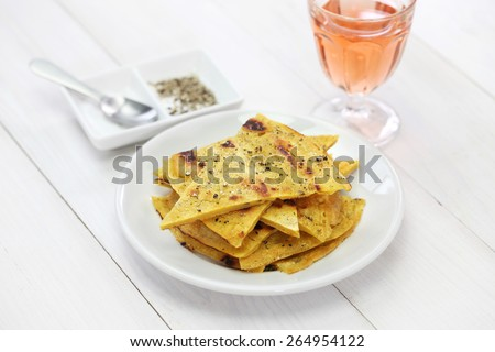 socca, farinata, chickpea pancake with rose wine - stock photo