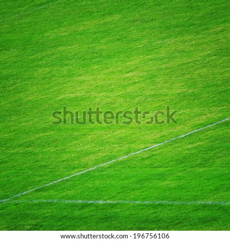 Soccer abstract field grass detail background. Grunge filter effect used. - stock photo
