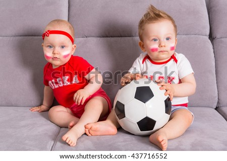 Soccer baby fans of Poland team in national colors - stock photo