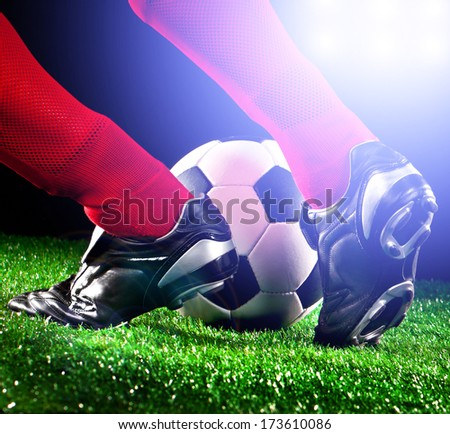 soccer ball and feet on the football field