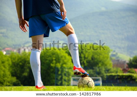 Soccer ball at the kickoff of a game - stock photo