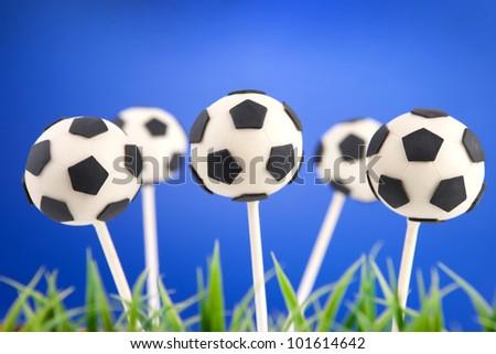Soccer ball cake pops - stock photo