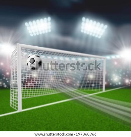 soccer ball flies into the goal - stock photo
