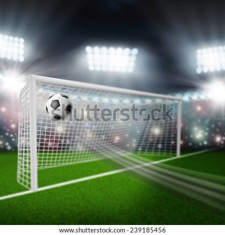 soccer ball flies into the goal - stock photo
