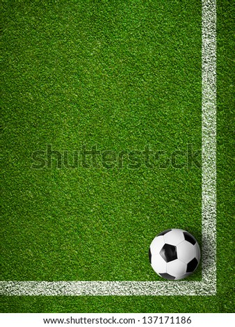 Soccer ball framed by white marking lines top view. Sport background. - stock photo