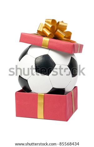 Soccer ball in a gift box. Isolated on white background. - stock photo