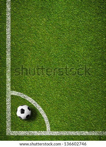 Soccer ball in corner kick position. Football field top view. - stock photo