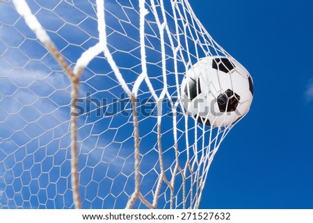 soccer ball in goal against the backdrop of the sky. - stock photo
