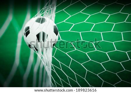 soccer ball in goal, football game - stock photo