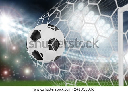soccer ball in goal net - stock photo