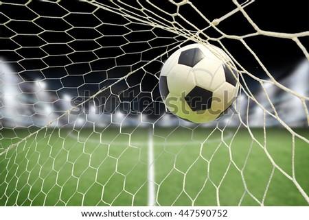 Soccer ball goal spotlight stock photo 447590752 shutterstock soccer ball in goal with spotlight reheart Choice Image