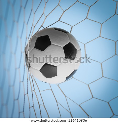 soccer ball in net on blue sky - stock photo