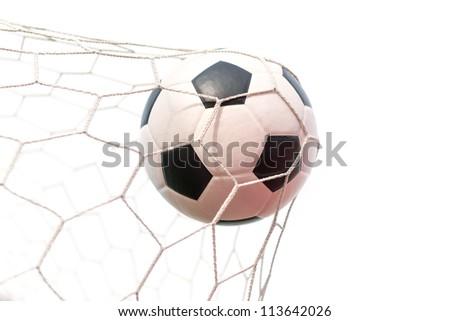soccer ball in net on white - stock photo