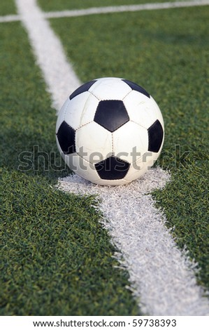 Soccer ball in the center of the field of a stadium - stock photo