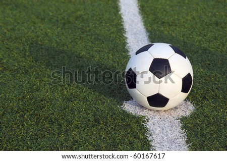 Soccer ball in the center of the field of a stadium