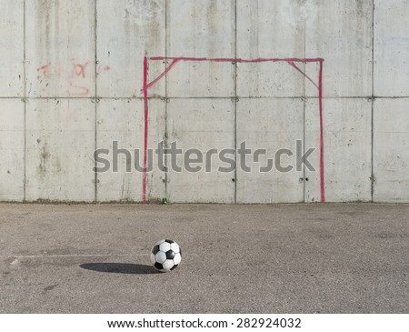 Soccer ball in the city - stock photo