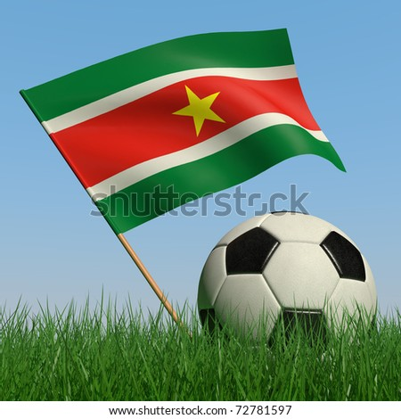 Soccer ball in the grass and the flag of Surinam against the blue sky. 3d - stock photo