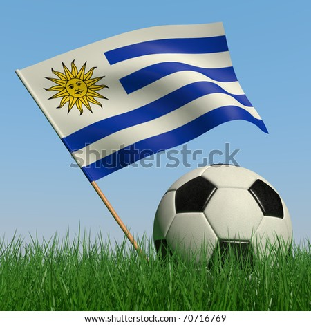 Soccer ball in the grass and the flag of Uruguay against the blue sky. 3d - stock photo