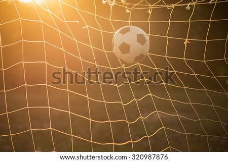 Soccer ball in the strong sunlight conditions. - stock photo