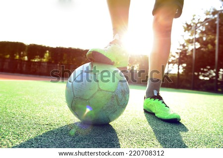 Soccer ball ��°nd  legs of players in soccer shoes. - stock photo