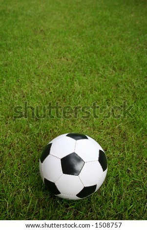 Soccer ball on a field - stock photo